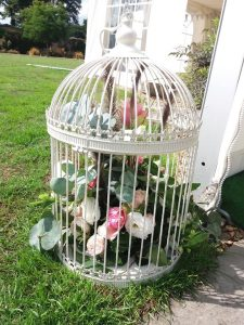 Birdcage display of pink and white flowers