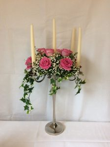 candalabra rose table centre piece